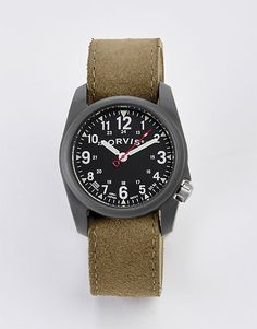 Go the distance with this classic military-style field watch bearing both 12- and 24-hour markings. Crafted of durable matte-finish polyresin, this field watch boasts Swiss Super-LumiNova® hands and markers for fast, accurate viewing. Hard-wearing nylon and Tridura bands offer a quick, tool-less band change. Weighs a mere 1.5 ounces. Pro-Guard protective cover. Hardened mineral crystal. Quartz movement. In dark olive. Case diameter 40mm. Water resistant to 164 feet. Imported.