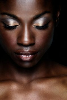 Love this make up and the lighting.  Like the artistic nature of the shot.  Would be good with necklace displayed