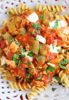 Crock Pot Italian Chicken with Tomatoes – This scrumptious, cheesy slow cooker meal is perfect for lazy weekends or weeknights! | thecomfortofcooking.com