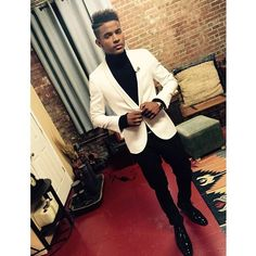 Trevor Jackson looked so stylish and dapper showing off a white blazer and black turtleneck in his latest Instagram pic. Every single detail of his look - from his cool haircut to his shiny dress shoes - is absolute perfection!