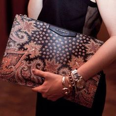 Working for an employer like Dolce and Gabbana means dressing for the job! I want to style at my medium with solid darker shades of clothing but with a hero accessory like this fab Givenchy clutch!