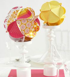 Easy cut-and-fold shapes combine to make cheerful dimensional spheres. Use patterned and solid paper in your wedding colors for a fun, fresh look. These would be a super cute ornament centerpiece around the holidays with green or red paper. Paper Centerpieces, Simple Centerpieces, Wedding Centerpieces, Centerpiece Ideas, Wedding Decorations, Old Christmas, Christmas Crafts, Arts And Crafts, Paper Crafts