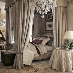 I love everything about this bedroom. The heather grey tones, beautiful chandelier and the drapery around the bed- fit for a queen