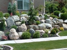 Piles Or Large Landscape Rocks For Beautiful Gardens With Green Plants And  Colorful Flowers
