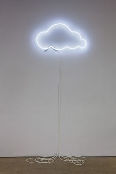artist laurel woodcock cloud an outline of a cloud in white neon is hung quite high on the wall - Cloud Lamp Diy