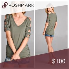 "Olive Cold Shoulder Cutout Top Olive Green Cold Shoulder Top. Quarter Length Sleeves with Cute Cutouts Running down them. V-Neckine with Ruching on the Sides.  Lightweight and Soft. 95% Rayon 5% Spandex. Made in the USA!   ✨Use the ""Buy Now"" or ""Add to Bundle"" Button to select your size for Purchasing✨ Boutique Tops Tees - Short Sleeve"