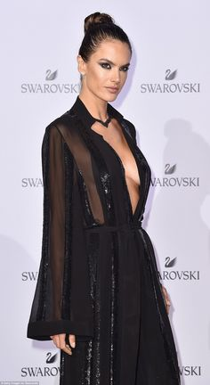 Simply stylish:Cinching in her tiny waist, the garment balanced out the perilous neckline...