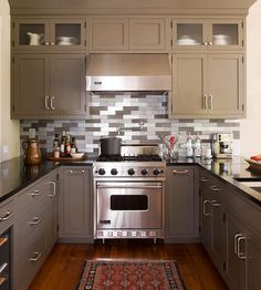 Stove and hood. THIS is what I want. NO microwave over the stove. (But no faucet on the wall -- expensive overkill!)