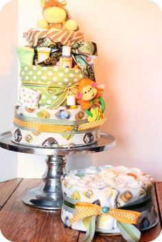 LOVE diaper cakes. Just saw a beautifully done diaper cake at a baby shower recently! Great for decorations, OR if you get short on diapers:D