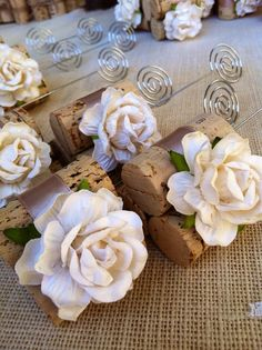 This could be perfect for table numbers using pre made burlap roses!!!! Rustic Wedding Table Number Holders