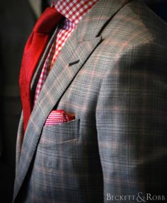 beckettrobb: A bold glen plaid pattern with a prominent red windowpane gives this suit a little extra pop.  The contrasting buttons and buttonholes help give it that custom look.  Custom suit and shirt by Beckett & Robb.  Accessories also from B.
