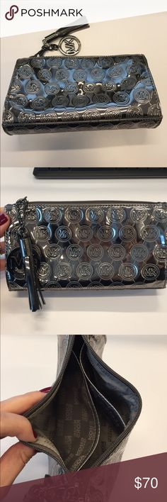 Michael Kors Cosmetic Bag Beautiful cosmetic bag by Michael Kors. Made of patent leather with top zip closure. Two organization compartments inside. Logo print and removable logo with tassel. Pewter color. MICHAEL Michael Kors Bags Cosmetic Bags & Cases