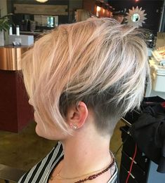 20 Bold and Daring Takes on the Shaved Pixie Cut Long Blonde Pixie With Undercut Long Wavy Hair, Short Hair Cuts, Short Hair Styles, Short Pixie, Asymmetrical Pixie Cuts, Blonde Pixie, Undercut Hairstyles, Pixie Hairstyles, Undercut Pixie