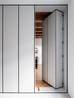 TRN flat reconstruction is a project by architect P. Jurkovic tried to turn part of the former monastery in a modern apartment of 100 sq m; guiding element is a movable library, which is the entrance to the bedroom. Architecture Renovation, Hidden Rooms, Bright Rooms, Secret Rooms, Wardrobe Design, Closet Doors, Door Design, Windows And Doors, Tall Cabinet Storage
