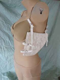 An Etsy shop with some homemade holsters.  Insteresting concepts and I applaud her ingenuity but I'm not sure any of these are a viable option.  --- Concealed Carry Bra Holster CCW Gun Holster by Shooting Tulips .380s, 9mm, .38 Cream, Nude, Black via Etsy