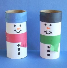 Little snowmen made out of toilet paper rolls and construction paper