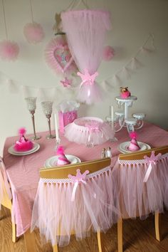 Beautiful Pink Princess Theme Table ! Great Idea putting a tutu on the backs of the chairs, girls can take them home after the party as a favor !