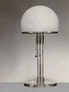 Vintage table lamp, Bauhaus studio (design by K. J. Jucker e W. Wagenfeld) - Photo by Lucia Moholy, 1923/1924