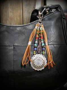 Southwest Purse Tassel beaded in a Native American  design with concho and leather tassels.