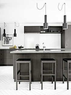 In the kitchen, the square stools echo the lines and tones of the kitchen cabinetry, while Alvar Aalto pendant lights add a subtle curved contrast. Buy Furniture Online, Cheap Furniture, Furniture Decor, Pallet Furniture, Office Furniture, Industrial Kitchen Design, Kitchen Interior, Wooden Kitchen Cabinets, Kitchen Dinning Room
