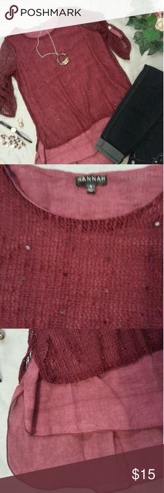 Open knit over cotton high low tunic Maroon colored high low tunic that is open knit with sequins scattered throughout over cotton lighter colored lining that is longer than the knit. The sleeves are not lined making them see through with a buttoned tab. I only wore this top 3 times. EUC Hannah Tops Blouses