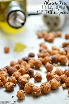 These Gluten Free Italian Parmesan Roasted Chickpeas are baked until crispy then tossed in olive oil with a mixture of Italian spices and Parmesan cheese. A great, healthy way to snack! Salty Snacks, Quick Snacks, Yummy Snacks, Snack Recipes, Cooking Recipes, Simple Snacks, Gluten Free Snacks, Gluten Free Recipes, Italian Spices
