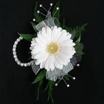 """A fresh and fun corsage, this one featuresgerbera daisy in your choice of color!Includes keepsake Rhinestone wristlet, crystal pins, and accents!  Approximate size is 2.5""""W x 4.5""""L.  Custom Colors available , Select Flower..."""