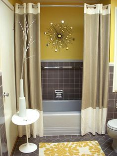 Awesome idea- Not a fan of the color but I like the 2 curtains   Yellow  gray small bathroom. threelegfred