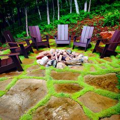 Boulder fire pit with flagstone patio and moss jointing.