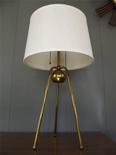 MID CENTURY MODERN Atomic Brass Tripod Table Lamp Gerald Thurston  This is a timeless design that offers a presence about it that's hard to beat. This lamp is very unique and I believe it to be designed by Gerald Thurston Circa 1950′s, who was Lightoliers in-house designer. It features sleek and modern lines. It …