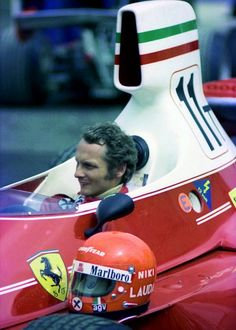 Niki Lauda and his 1975 Ferrari 312T. Formula 1 World Champion of 1975, 1977, and 1984.