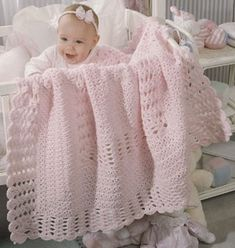 """Clusters & Shells Baby Crochet Afghan ePattern - Number of Designs: 1 baby afghanSize: 37"""" x 37""""Designer: Cathy Hardy Original Publication: Leisure Arts Leaflet #2055, Baby Blocks †Description: A sweet, lacy afghan for a little girl. Marvelous in pink, it would be equally sweet in ecru or white. It is crocheted in rounds using worsted weight yarn and a size I (5.50 mm) hook. †Product Type: Digital Download ThemesAfghans"""