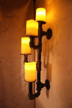 Industrial pipe candle holder wall sconce by DutchMommaDesigns