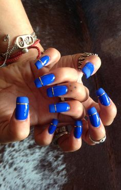 "Brooke Candy's bright blue nails using Sally Hansen, Essie ""matte about you"" top coat and a gold striping tape from MK beauty club"