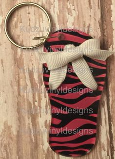 "3"" Zebra Print in pink and black acrylic keychain, Any monogram can be added to the flip flop as well. $8.00 each plus shipping if needed."