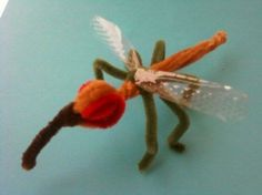 Mosquitoes made out of pipe cleaners and plastic (from cookie plastic tin). Fun craft idea!