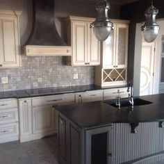 Soapstone & Verde Peacock Granite. Crestwood Design Center cabinetry, which we install.