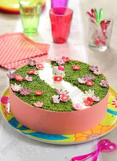 Incredibly cute springtime themed Hello Kitty Cake.