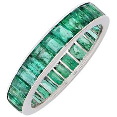 Natural Emerald Eternity Band | See more rare vintage Band Rings at https://www.1stdibs.com/jewelry/rings/band-rings