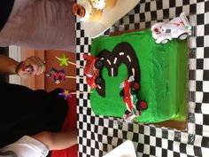 Race car birthday cake! Filling: half oreo with yellow cake/ half chocolate with chocolate chips- delicious!