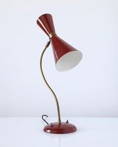 Turn on the light with this 1950s Brazilian table lamp featuring a red shade in spun metal. via- vintage, lighting, design