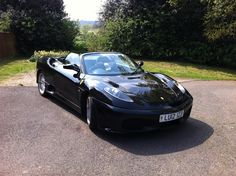 Black car with standard front and Scudo rear end with high level exhaust. Ferrari F430 replica based on Toyota MR2 roadster built by XLR8.me.uk from EDF430 bodykit