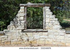 window in an old stone wall