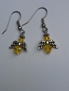 Yellow, Genuine Swarovski Bicone Angel Earrings  $14.99  These lovely yellow, genuine Swarovski bicone Angel earrings remind us that our Angels are always with us. This is the color of the 3rd/Solar Plexus chakra. Yellow is the color of the Third Ray, your Ego personality. Yellow supports our perseverance, getting things done and follow through.  Handmade with Love in the USA
