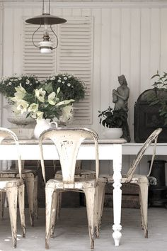 Embrace industrial vintage with distressed white paint & metal finishes.