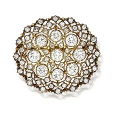 A diamond brooch, Buccellati  the oval-shaped panel of openwork design set throughout with round brilliant-cut diamonds; signed Buccellati; with signed box; estimated total diamond weight: 5.80 carats; mounted in eighteen karat gold
