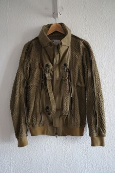 I am the original owner of this jacket, and can attest to its rarity and price. Wore maybe five times total. Button and zipper closure, mesh lining, perforated outer, raglan shoulders, overwhelmingly beautiful construction (especially at where collar folds into neck without any seams--like origami--), nylon hood. | eBay!