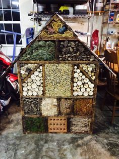 Our bug house or bug motel we made to attract beneficial insects to our garden so they stay and eat the bad bugs that try to eat our gaarden. We built this out of recycled material like pallets, tin cans, bricks. etc.
