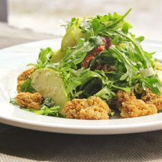 Pan-fried oysters and fresh peppery greens - what a combo -- Frisee and Arugula Salad with Pan Fried Oysters and Creamy Fennel Dressing