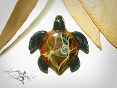 https://www.etsy.com/ca/listing/259933213/glass-pendant-baby-rainbow-galaxy-turtle?ref=shop_home_active_22